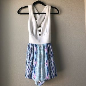 NWT Bebe Cross-Back Romper with pockets